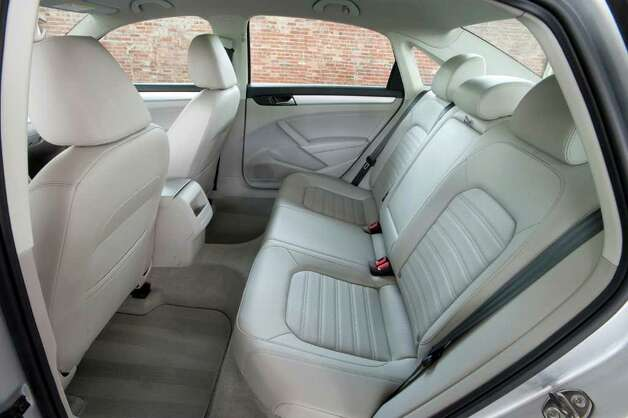 The back seat of the 2012 Volkswagen Passat has room for three, and there is ample space for long legs, even when the front seats are all the way back. COURTESY OF VOLKSWAGEN OF AMERICA INC. Photo: Volkswagen Of America Inc., COURTESY OF VOLKSWAGEN OF AMERICA INC.