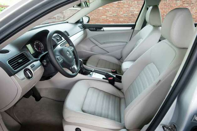 The cockpit of the 2012 Volkswagen Passat includes comfortable bucket seats; and leather upholstery is included with the top model, the SEL. COURTESY OF VOLKSWAGEN OF AMERICA INC. Photo: Volkswagen Of America Inc., COURTESY OF VOLKSWAGEN OF AMERICA INC.