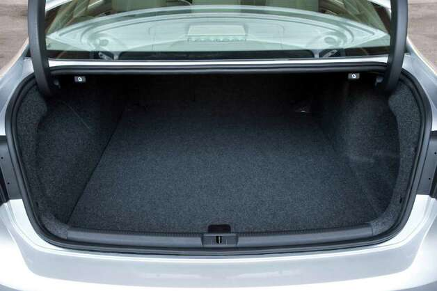 The deep and wide trunk of the 2012 Volkswagen Passat sedan has 15.9 cubic feet of cargo space, and on some models there is a pass-through to the rear seating area. COURTESY OF VOLKSWAGEN OF AMERICA INC. Photo: COURTESY OF VOLKSWAGEN OF AMERICA INC.