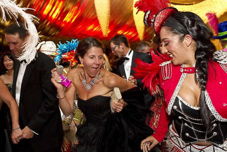 Lauren Hickey (center) dances along with carnival dancers while moving from the patron's dinner tent to the performance during the San Francisco Symphony Opening Night Gala in San Francisco, Calif., on Wednesday, September 7, 2011. Photo: Laura Morton, Special To The Chronicle