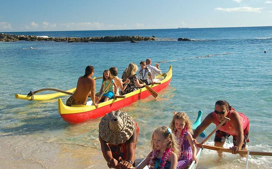 Outrigger canoe rides in one of Ko Olina's natural coves are part of the Paradise Cove Lu'au experience. Photo: Jeanne Cooper, Special To SFGate