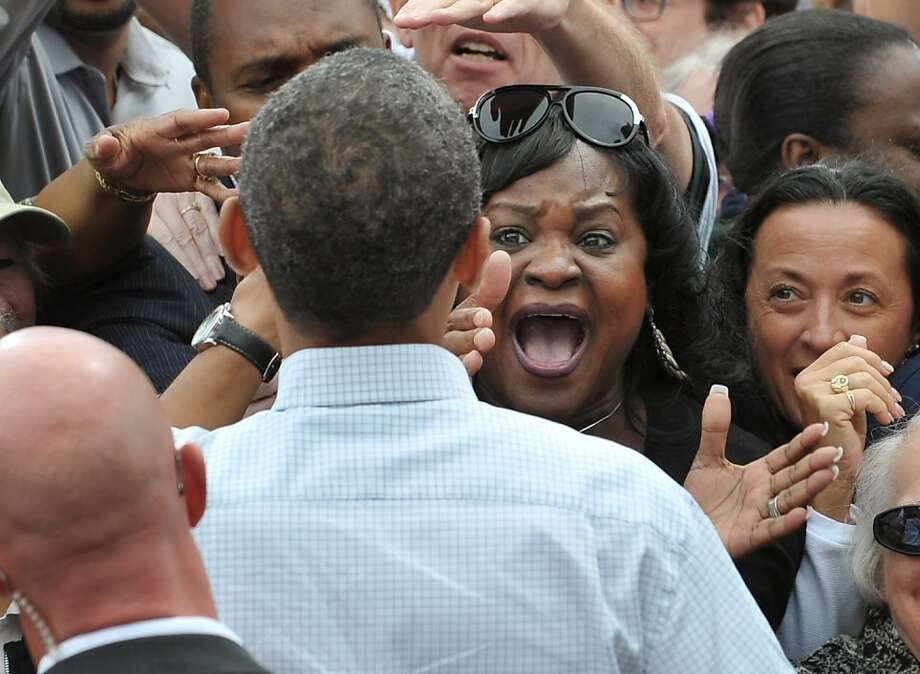 A woman screams as US President Barack Obama greets attendees after speaking at Labor Day celebrations on September 5, 2011 outside General Motor's world headquarters in Detroit. Obama is in Detroit to address the annual Labor Day event sponsored by the Metro Detroit Central Labor Council.     AFP PHOTO/Mandel NGAN (Photo credit should read MANDEL NGAN/AFP/Getty Images) Ran on: 09-06-2011 President Obama gets a rousing welcome at a Labor Day rally outside the GM headquarters in Detroit. Obama will give a jobs speech to Congress this week. Photo: Mandel Ngan, AFP/Getty Images