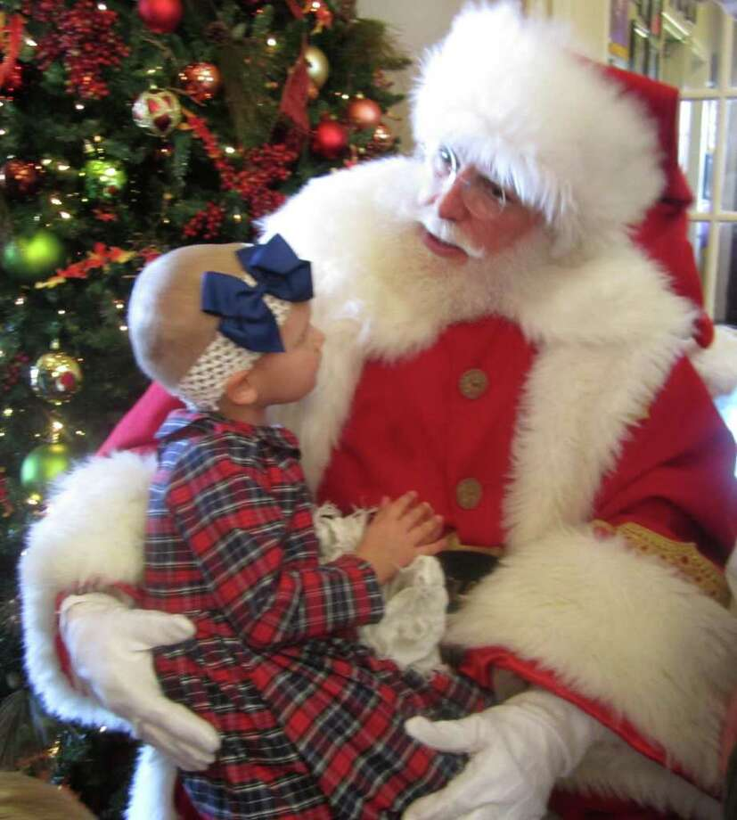 COURTESY: FIRETHORNE SPECIAL VISIT: Lucy Schuler, 3, visits with Santa.