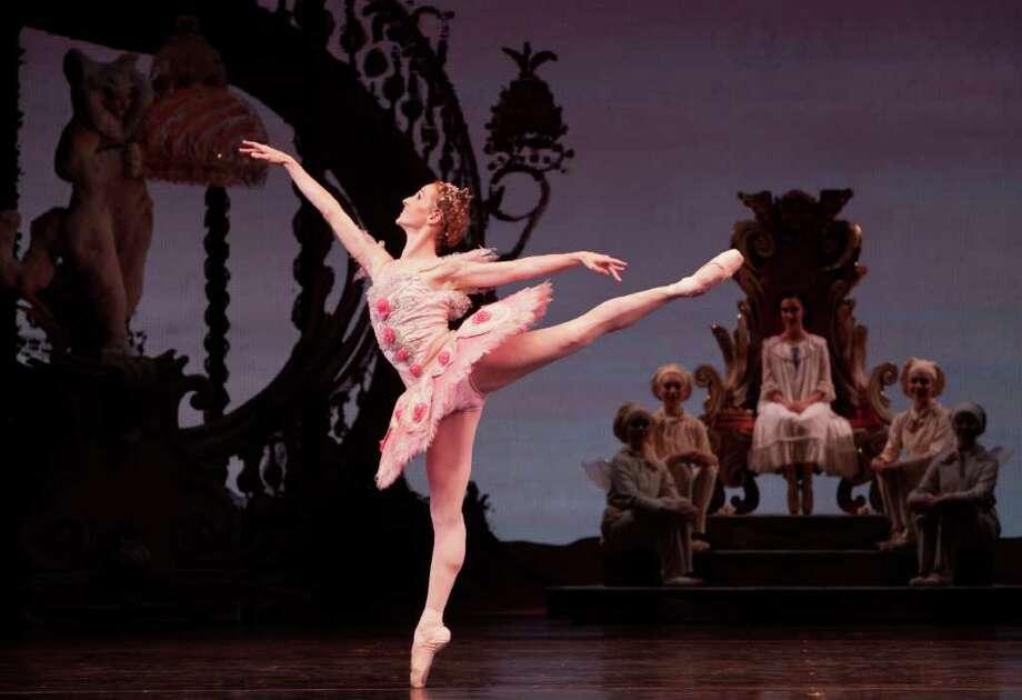 Sara Webb sparkles as the Sugar Plum Fairy in Houston Ballet's production of The Nutcracker, choreographed by Ben Stevenson. Emily Bowen, seated, is a sweet-spirited Clara. Photo: Amitava Sarkar / Amitava Sarkar