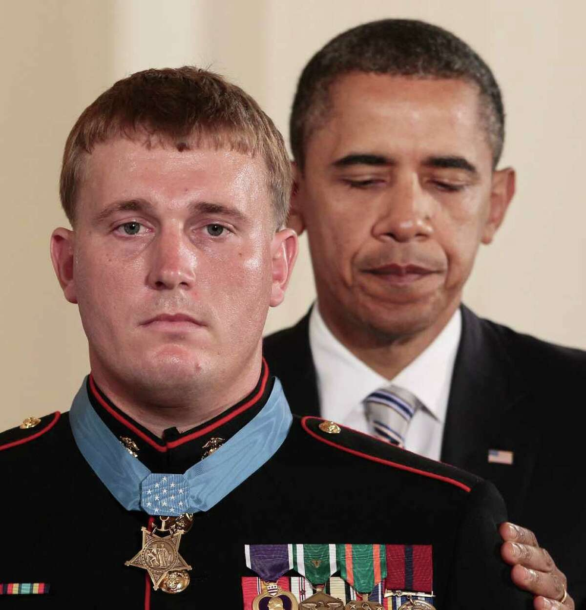 FILE - In this Sept. 15, 2011 file photo, President Barack Obama awards the Medal of Honor to former Marine Corps Cpl. Dakota Meyer, 23, from Greensburg, Ky., during a ceremony in the East Room of the White House in Washington. Meyer is suing defense contractor BAE Systems OASYS Inc., claiming that a manager at the company ridiculed his Medal of Honor, called him mentally unstable and suggested he had a drinking problem, thereby costing him a job.