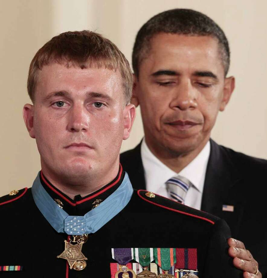 FILE - In this Sept. 15, 2011 file photo, President Barack Obama awards the Medal of Honor to former Marine Corps Cpl. Dakota Meyer, 23, from Greensburg, Ky., during a ceremony in the East Room of the White House in Washington. Meyer is suing defense contractor BAE Systems OASYS Inc., claiming that a manager at the company ridiculed his Medal of Honor, called him mentally unstable and suggested he had a drinking problem, thereby costing him a job. Photo: AP