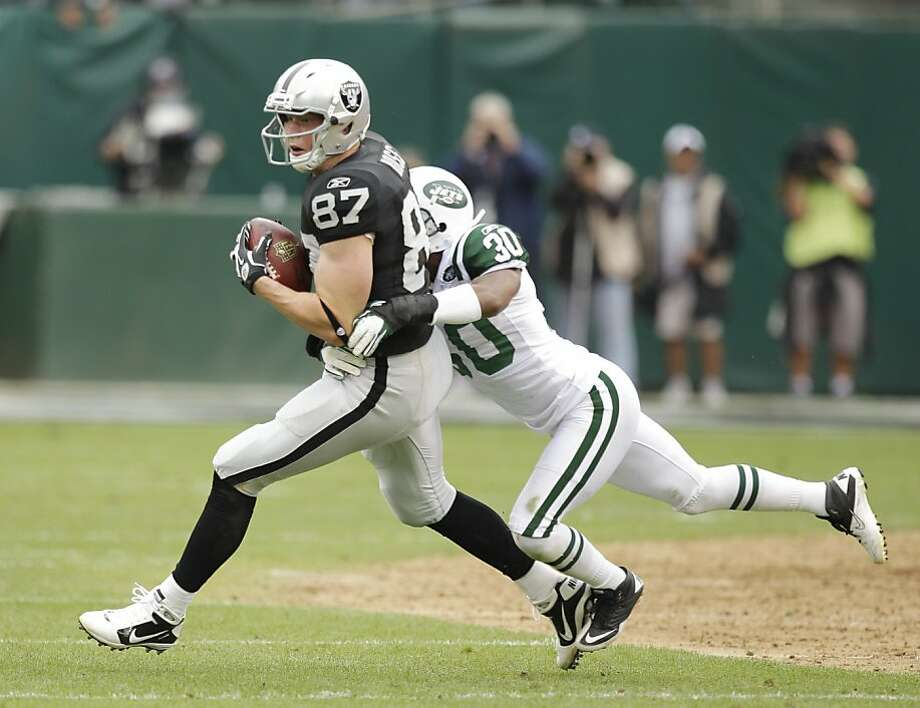 Oakland Raiders tight end Kevin Boss (87) in action against New York Jets defensive back Kyle Wilson (20) during the second quarter of an NFL football game in Oakland, Calif. Sunday, Sept. 25, 2011. (AP Photo/Ben Margot) Photo: Ben Margot, AP
