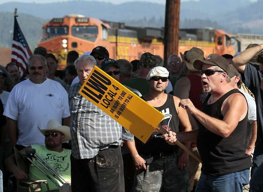 Union workers block a grain train in Longview, Wash., Wednesday, Sept. 7, 2011. Longshoremen blocked the train as part of an escalating dispute about labor at the EGT grain terminal at the Port of Longview. (AP Photo/Don Ryan) Photo: Don Ryan, AP