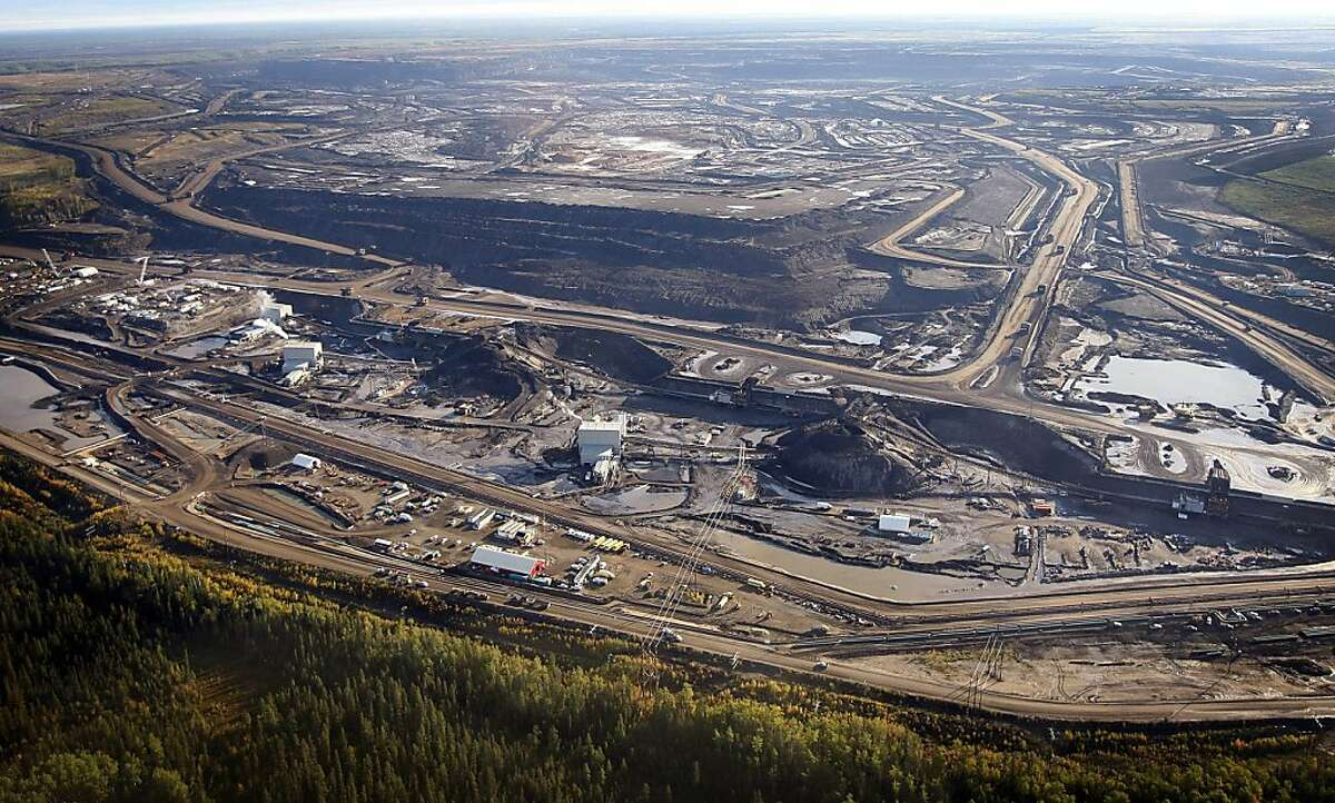 This Sept. 19, 2011 aerial photo shows a tar sands mine facility near Fort McMurray, in Alberta, Canada. Environmentalists hoping to block a proposed underground oil pipeline that would snake 1,700 miles from Canada to the Gulf of Mexico have pinned their hopes on an unlikely ally _ the conservative state of Nebraska where opposition to Keystone XL pipeline has risen steadily since the project was proposed three years ago. Public hearings will start Sept. 27, in Lincoln on the 16-inch steel pipe that if built would carry oil extracted from tar sands in Alberta, Canada, through Montana, South Dakota, Nebraska, Kansas and Oklahoma to refineries in Texas. (AP Photo/The Canadian Press, Jeff McIntosh) Ran on: 09-27-2011 The U.S. State Department is weighing the construction of a 1,700-mile pipeline to bring oil from tar sands mines like this one in Alberta, Canada, to the Gulf of Mexico.