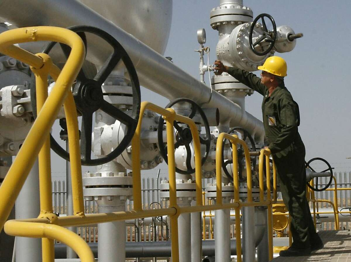 FILE - In this Tuesday, April 15, 2008 file photo Iranian oil technician Majid Afshari checks the oil separator facilities in Azadegan oil field, near Ahvaz, Iran. Cities in Iran, India, Pakistan and the capital of Mongolia rank among the worst on the planet for air pollution, while those in the U.S. and Canada are among the best, according to the first global survey, released Monday Sept. 26, 2011 by the World Health Organization. The southwest Iranian city of Ahvaz walked away with the unfortunate distinction of having the highest measured level of airborne particles smaller than 10 micrometers. (AP Photo/Vahid Salemi, File)