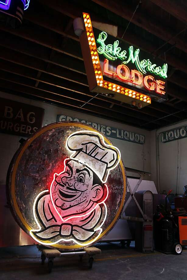Jim Rizzo has been called the king of neon. He restores old neon, makes new environmentally friendly neon in his 10,000-sq-ft studio, that's more like a neon museum, two old classics from the past, formally from San Francisco are the Lake Merced Lodge sign that hangs above the old San Francisco original Joes sign built in 1957. Wednesday August 31, 2011 in Oakland, California. Photo: Lance Iversen, The Chronicle