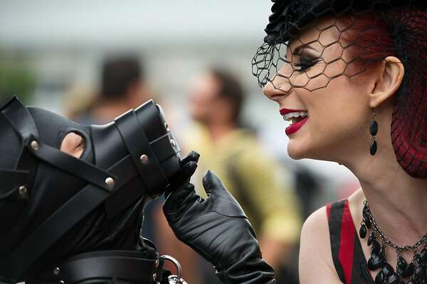 Performance artist Liliane Hunt plays with other performers during the Folsom Street Fair 2011 on September 25, 2011 in San Francisco, Calif.