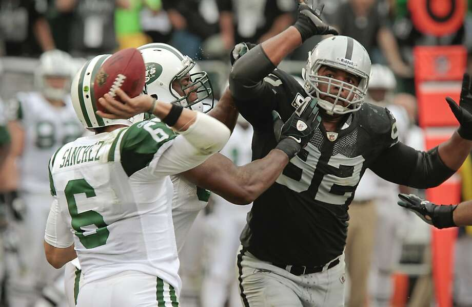 Raider Richard Seymour pressures Jets quarterback during the Raiders-Jets game in Oakland, Calif., on Sunday, September 25,  2011.   Ran on: 10-01-2011 Richard Seymour, pressuring the Jets' Mark Sanchez, says his attention is focused on helping the Raiders. Photo: John Storey, Special To The Chronicle