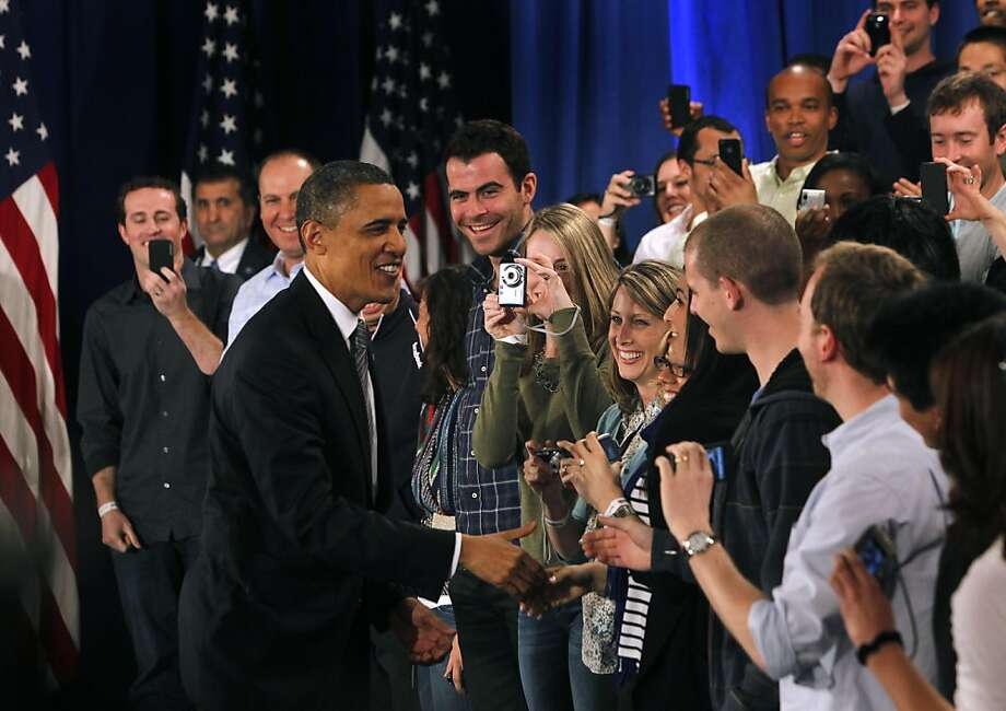 President Obama greets Facebook employees before leading a town hall-style meeting to discuss the economy and the national debt in Palo Alto, Calif. on Wednesday, April 20, 2011. Facebook hosted the gathering at its headquarters and made it available for the public to participate and ask questions on its website. Photo: Paul Chinn, The Chronicle