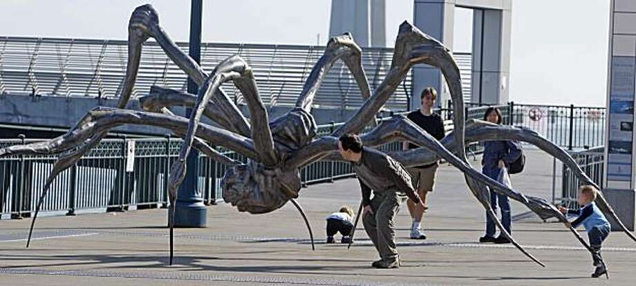 Louise Bourgeois's Crouching Spider. public art and the constant debate over it. The latest is the 10-foot high bronze spider at Embarcadero and Mission NEVIUS18_0111_KR.jpg Kurt Rogers / The Chronicle  Photo taken on 11/17/07, in San Francisco, CA, USA Ran on: 11-18-2007 CROUCHING SPIDER: Louise Bourgeois' 10-foot high bronze arachnid at Embarcadero and Mission streets may rekindle an old debate over public art. Ran on: 11-18-2007   Ran on: 06-02-2010 Photo caption Dummy text goes here. Dummy text goes here. Dummy text goes here. Dummy text goes here. Dummy text goes here. Dummy text goes here. Dummy text goes here. Dummy text goes here.###Photo: bourgeois02_ph21195171200San Francisco Chronicle###Live Caption:Louise Bourgeois's Crouching Spider, a 10-foot high bronze spider at Embarcadero.###Caption History:Louise Bourgeois's Crouching Spider. public art and the constant debate over it. The latest is the 10-foot high bronze spider at Embarcadero and Mission__NEVIUS18_0111_KR.jpg__Kurt Rogers - The Chronicle____Photo taken on 11-17-07, in San Francisco, CA, USA__Ran on: 11-18-2007__CROUCHING SPIDER: Louise Bourgeois' 10-foot high bronze arachnid at Embarcadero and Mission streets may rekindle an old debate over public art.__Ran on: 11-18-2007###Notes:###Special Instructions:MANDATORY CREDIT FOR PHOTOG AND SAN FRANCISCO CHRONICLE-NO SALES-MAGS OUT Photo: Kurt Rogers, The Chronicle