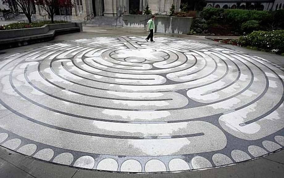 The Grace Cathedral's labyrinth is photographed in San Francisco, Calif. on Wednesday, February 25, 2009. Ran on: 03-19-2009 The Grace Cathedral's terrazzo outdoor labyrinth is a place where you can quiet your mind before entering the famed Nob Hill site. Ran on: 03-19-2009 The Grace Cathedral's terrazzo outdoor labyrinth is a place where you can quiet your mind before entering the famed Nob Hill site. Photo: Mark Costantini, The Chronicle
