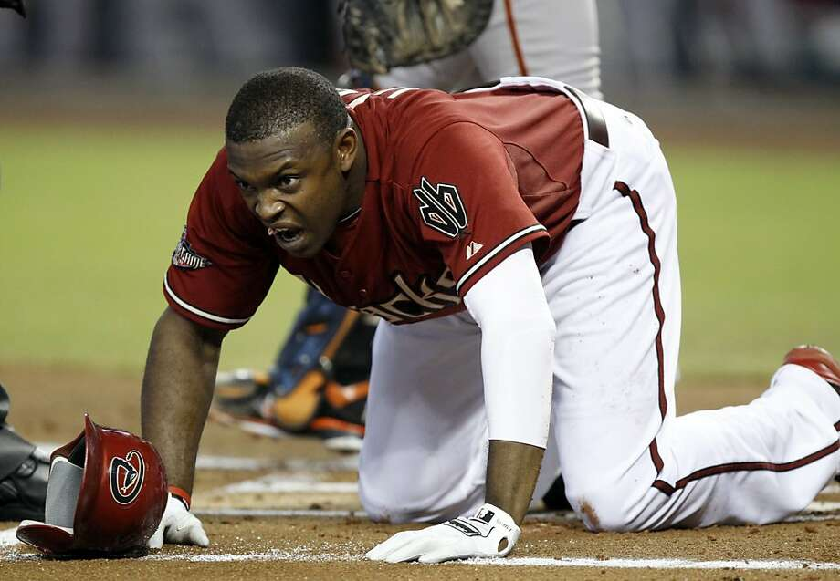 Arizona Diamondbacks' Justin Upton gets up onto his knees after being hit by a pitch from San Francisco Giants' Tim Lincecum in the first inning of an MLB baseball game, Sunday, Sept. 25, 2011, in Phoenix. (AP Photo/Paul Connors) Photo: Paul Connors, AP