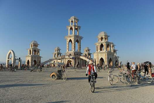 In this Sept. 1, 2011, photo, people gather at the temple built for Burning Man.  Photo: Andy Barron, AP