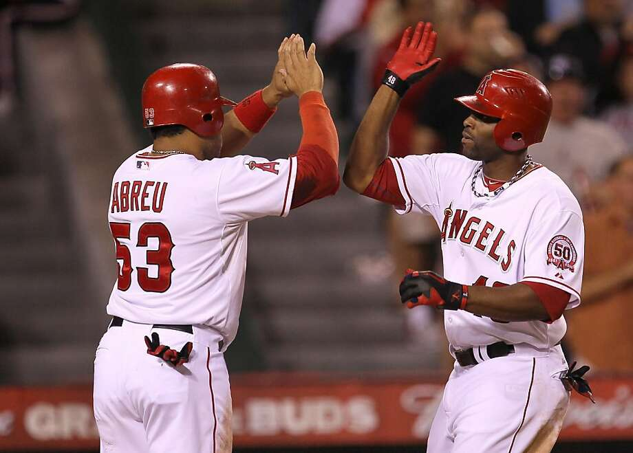 ANAHEIM, CA - SEPTEMBER 24:  Torii Hunter #48 and Bobby Abreu #53 of the Los Angeles Angels of Anaheim celebrate as both score on Hunter's two run home run in the sixth inning against the Oakland Athletics in the first inning on September 24, 2011 at Angel Stadium in Anaheim, California.  (Photo by Stephen Dunn/Getty Images) Photo: Stephen Dunn, Getty Images