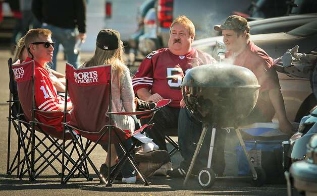 A group of 49er fans cooking on the weber outside Candlestick Park before the 49er-Texans game in San Francisco, Calif., on August 26th, 2011. Photo: John Storey, Special To The Chronicle