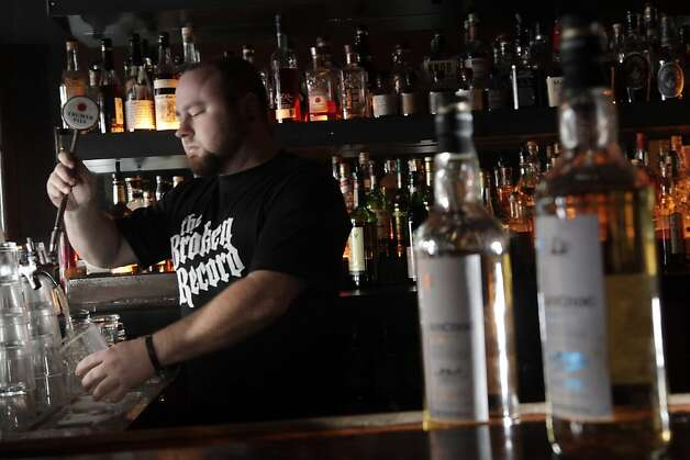 Broken Record owner Jason King preparing a boilermaker on Wednesday, December 22, 2010, at his bar in San Francisco, Calif. The boilermaker he is making is made from Trumer Pilsner with the highland-malt whisky An Cnoc Photo: Carlos Avila Gonzalez, The Chronicle