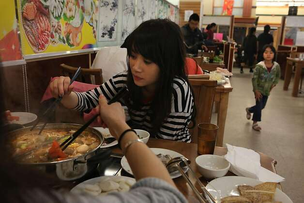 International exchange student Ying-Chen Lo from Taiwan having a hot pot buffet at Oceanview Supermarket  in San Francisco, California, on Wednesday, August 31, 2011. Photo: Liz Hafalia, The Chronicle
