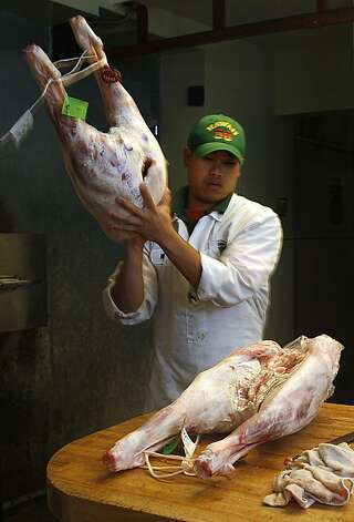 Matt Pettie placing lamb on the butcher block at Guerra Quality Meats in San Francisco, California, on Friday, September 16, 2011.  Guerra's has been a family business for over fifty years, and Matt has been a butcher for Guerra's for fourteen years. Photo: Liz Hafalia, The Chronicle