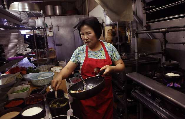 Head chef Jeong-ok Hong (middle) prepping an order at Han Il Kwan, 1802 Balboa St. in San Francisco, California, on Monday, September 19, 2011. Photo: Liz Hafalia, The Chronicle