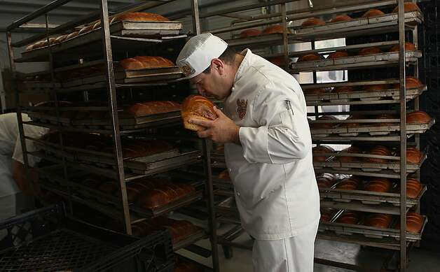 "Master baker Fernando Padilla smelling freshly baked loaves as it cools off at Boudin Bakery on 10th Ave. in San Francisco, California, on Wednesday, September 14, 2011.  Fernando apprenticed with former Boudin owner ""Papa Steve"" Giraudo at 17 years old.   Ran on: 09-25-2011 Photo caption Dummy text goes here. Dummy text goes here. Dummy text goes here. Dummy text goes here. Dummy text goes here. Dummy text goes here. Dummy text goes here. Dummy text goes here.###Photo: 49sq_09_PH11315785600SFC###Live Caption:Master baker Fernando Padilla smelling freshly baked loaves as it cools off at Boudin Bakery on 10th Ave. in San Francisco, California, on Wednesday, September 14, 2011.  Fernando apprenticed with former Boudin owner ""Papa Steve"" Giraudo at 17 years old.###Caption History:Master baker Fernando Padilla smelling freshly baked loaves as it cools off at Boudin Bakery on 10th Ave. in San Francisco, California, on Wednesday, September 14, 2011.  Fernando apprenticed with former Boudin owner ""Papa Steve"" Giraudo at 17 years old.###Notes:**Fernando Padilla  CQ###Special Instructions:MANDATORY CREDIT FOR PHOTOG AND SF CHRONICLE-NO SALES-MAGS OUT-TV OUT Photo: Liz Hafalia, The Chronicle"