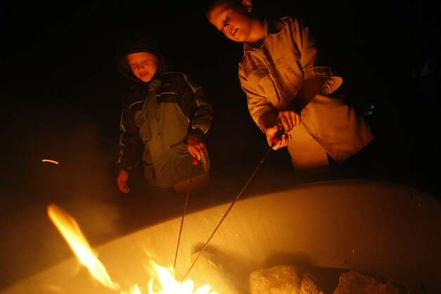 Daniel Heath, left, and Tyler Keasler roast marshmellows over the firepit in the Presidio campgrounds on August 24, 2011.Ê Photo: Maddie McGarvey, The Chronicle