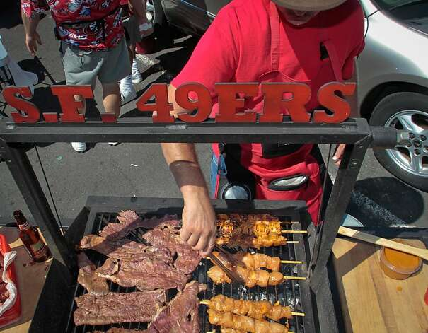 Eli Bequepps of Milpitas cooks Carne Asada and Chipotle Chicken at Candlestick Park before the 49er-Texans game in San Francisco, Calif., on August 26th, 2011. Photo: John Storey, Special To The Chronicle