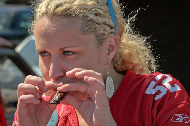 Lerin Murphy of Half Moon Bay has a bite of a bacon wrapped jalapeno at a tailgate party outside Candlestick Park before the 49er-Texans game in San Francisco, Calif., on August 26th, 2011. Photo: John Storey, Special To The Chronicle
