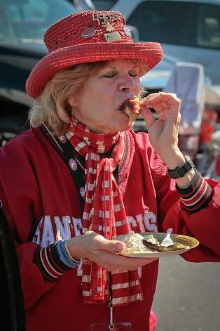 Doris Hadley of San Francisco  has a bite of a bacon wrapped artichoke heart at a tailgate party outside Candlestick Park before the 49er-Texans game in San Francisco, Calif., on August 26th, 2011. Photo: John Storey, Special To The Chronicle
