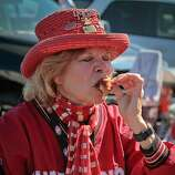 Doris Hadley of San Francisco  has a bite of a bacon wrapped artichoke heart at a tailgate party outside Candlestick Park before the 49er-Texans game in San Francisco, Calif., on August 26th, 2011.