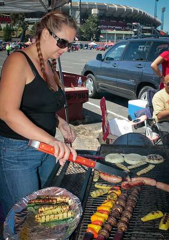 Christina Whippo of Santa Inez cooks veggies on the grill at Candlestick Park before the 49er-Texans game in San Francisco, Calif., on August 26th, 2011. Photo: John Storey, Special To The Chronicle