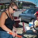 Christina Whippo of Santa Inez cooks veggies on the grill at Candlestick Park before the 49er-Texans game in San Francisco, Calif., on August 26th, 2011.