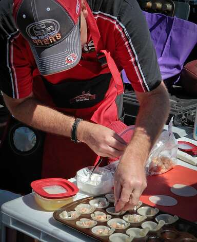 Joe Kopp of Fairfield fills shrimp cups for his tailgate party at Candlestick Park before the 49er-Texans game in San Francisco, Calif., is seen on August 26th, 2011. Photo: John Storey, Special To The Chronicle