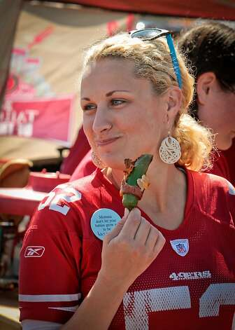 Lerin Murphy of Half Moon Bay enjoys a bacon wrapped jalapeno at a tailgate party outside Candlestick Park before the 49er-Texans game in San Francisco, Calif., on August 26th, 2011. Photo: John Storey, Special To The Chronicle
