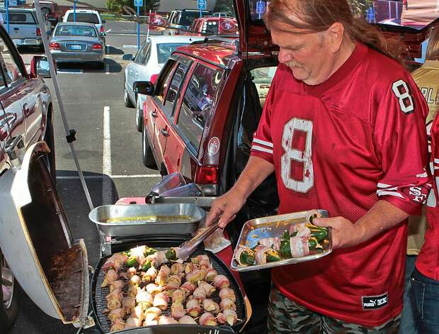 Patrick Garrsion of La Honda cooks bacon wrapped artichoke hearts and bacon wrapped jalapenos at Candlestick Park before the 49er-Texans game in San Francisco, Calif., on August 26th, 2011. Photo: John Storey, Special To The Chronicle