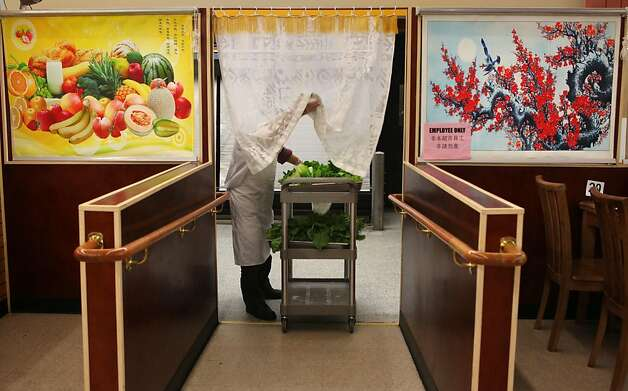 Ye Lang Zhang bringing fresh vegetables to the buffet at Oceanview Supermarket  in San Francisco, California, before the dinner hour on Wednesday, August 31, 2011. Photo: Liz Hafalia, The Chronicle