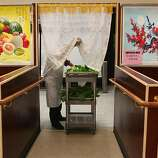 Ye Lang Zhang bringing fresh vegetables to the buffet at Oceanview Supermarket  in San Francisco, California, before the dinner hour on Wednesday, August 31, 2011.