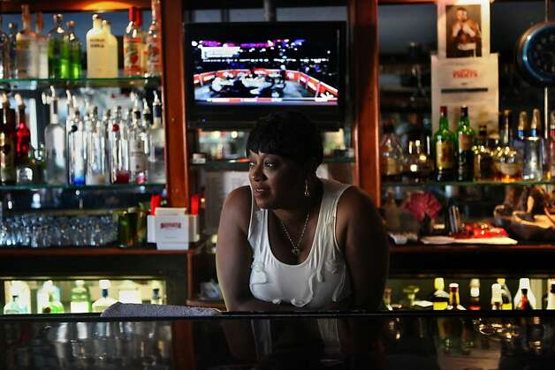 Denise Tucker, who's been a bartender at various bars in the district for the past 30 years, tending the bar at Sam Jordan's House of Ribs, 4004 3rd St., in San Francisco, California, on Tuesday afternoon, September 20, 2011.  She's been a bartender for Sam Jordan's during the past 9 years. Photo: Liz Hafalia, The Chronicle