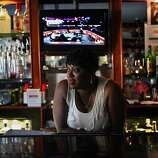 Denise Tucker, who's been a bartender at various bars in the district for the past 30 years, tending the bar at Sam Jordan's House of Ribs, 4004 3rd St., in San Francisco, California, on Tuesday afternoon, September 20, 2011.  She's been a bartender for Sam Jordan's during the past 9 years.