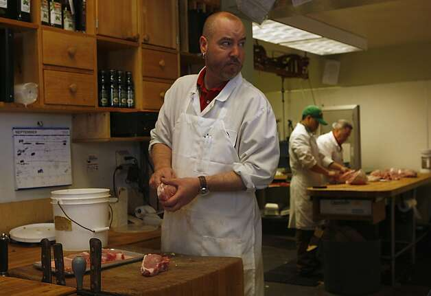 Butcher Danny Doyle preparing meat at Guerra Quality Meats in San Francisco, California, on Friday, September 16, 2011.  Guerra's has been a family business for over fifty years. Photo: Liz Hafalia, The Chronicle