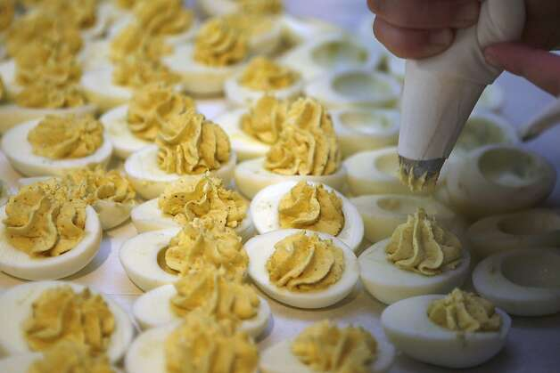 Paula Guerra making deviled eggs at Guerra Quality Meats in San Francisco, California, during the lunch hour on Friday, September 16, 2011.  Guerra's has been a family business for over fifty years. Photo: Liz Hafalia, The Chronicle