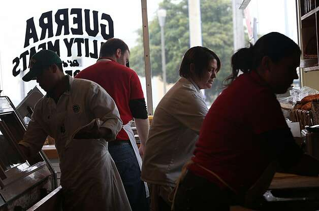 Butcher Matt Pettie, Mike McGee, deli chef Melanie Vigh (middle, right), and Paula Guerra (right), 20 years old, working at Guerra Quality Meats in San Francisco, California, during the lunch hour on Friday, September 16, 2011.  Guerra's has been a family business for over fifty years. Photo: Liz Hafalia, The Chronicle