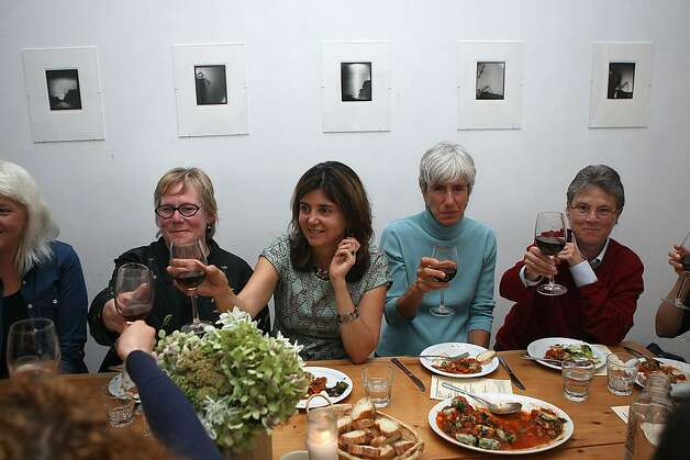 A toast being made after the producer dinner of Cowgirl Creamery cheeses at 18 Reasons in San Francisco, Calif., on Friday, August 19, 2011. Photo: Liz Hafalia, The Chronicle