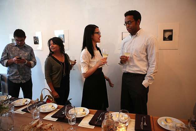 Left to right--Kevin Neel, Satarupa Bhattacharya, Bonnie Ng, and Derick McGee socialize before the producer dinner featuring Cowgirl Creamery cheeses at 18 Reasons in San Francisco, Calif., on Friday, August 19, 2011. Photo: Liz Hafalia, The Chronicle