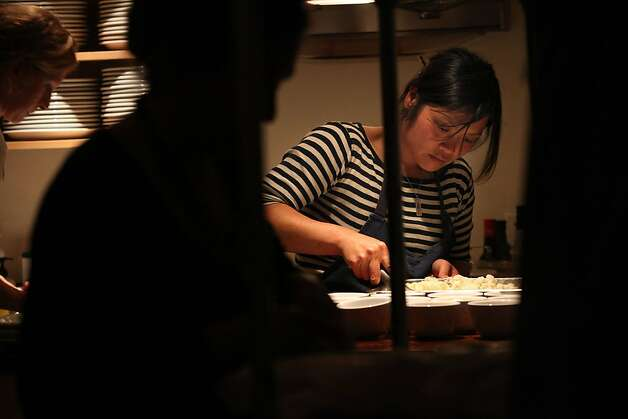 Head chef Linh Phu plating the fromage blanc ice cream for the producer dinner featuring Cowgirl Creamery cheeses at 18 Reasons in San Francisco, Calif., on Friday, August 19, 2011. Photo: Liz Hafalia, The Chronicle