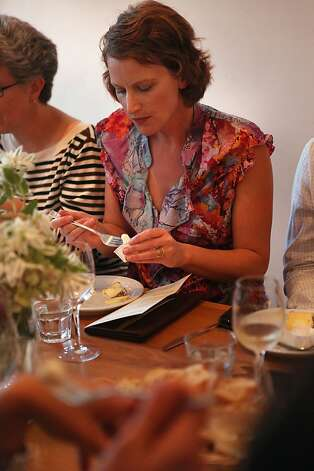 Cheesemaker Maureen Cunnie tasting her cheeses during the producer dinner featuring Cowgirl Creamery cheeses at 18 Reasons in San Francisco, Calif., on Friday, August 19, 2011. Photo: Liz Hafalia, The Chronicle